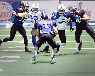 The Mahoning Valley Thunder's Quorey Payne (1) takes the ball down the field as he runs into teamates Chris Schubert (12) and C.J. Brewer (4) and Pioneers William TuTu Ferguson (22) and Allan Barnes (28) during the fourth quarter of the game at the arena formerly known as the Cheverolet Centre on Friday evening.