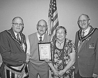 """<p>Special to The Vindicator</p> <p>PROUD MOMENT: A highlight of a recent meeting of the Grand Council of Royal and Select Masons of Ohio, Buechner Council 107, was the selection of Charles H. Houck Sr. as its """"Man of the Year."""" Sharing the proud moment with Houck, second from left, are, from left, Robert Rhinehart; Houck's wife, Judy; and James Parker VI.</p>"""