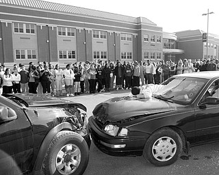 THIS COULD BE YOU: A mock crash staged for New Castle High School students Tuesday provided an example of what can happen when teens drink and drive, and don't wear a seat belt. Seniors at the school portrayed accident victims.