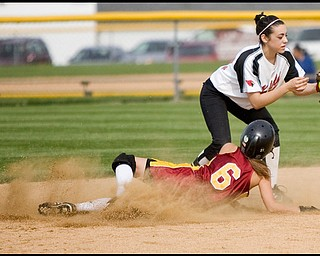 5.14.2009 Canfield's Gina Mancini (24) during holds onto the ball to tag Mooney's Margo Ucchino (6) out at second base during the bottom of the second inning at Boardman's Field of Dreams on Thursday evening. Geoffrey Hauschild