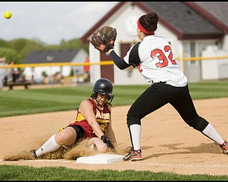 5.14.2009 Cardinal Mooney's Christina Hrehor (21) beats the throw to Canfield's Melanie West (32) landing safely at third base during the bottom of the fourth inning at Boardman's Field of Dreams on Thursday evening. Geoffrey Hauschild