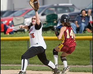 5.14.2009 Cardinal Mooney's Macy Ucchino (14) beats the throw to Canfield's Carlee Hart (15) landing safely at first base during the bottom of the fifth inning at Boardman's Field of Dreams on Thursday evening. Geoffrey Hauschild