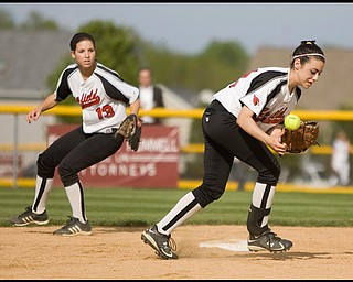 5.14.2009 Canfield's Gina Mancini (24) goes after a bobbled ball in front of teamate Cara Cupler (13) during the bottom of the fifth inning at Boardman's Field of Dreams on Thursday evening. Geoffrey Hauschild