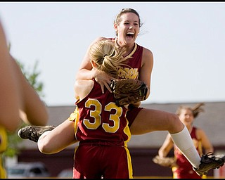 5.14.2009 Cardinal Mooney's Cadi Sheffler (11) leaps into the arms of Shayla Decapita (33) after defeating Canfield in softball at Boardman's Field of Dreams on Thursday evening. Geoffrey Hauschild