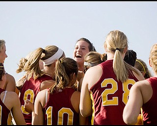 5.14.2009 Cardinal Mooney's Cadi Sheffler (11) celebrates with her teammates after pitching a defeat over Canfield in softball at Boardman's Field of Dreams on Thursday evening. Geoffrey Hauschild