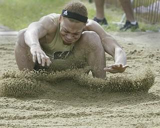 Harding's Desmond Reed lands during long jump at Chaney meet Thursday.