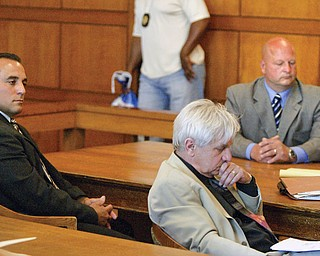 FOUND GUILTY: Former Trumbull County deputy sheriffs Anthony Leshnack, left, and Peter Pizzulo wait in common pleas court after entering no-contest pleas to a felony charge of grand theft. In the center is J. Gerald Ingram, who represented Leshnack. A judge found both men guilty Friday. They will be sentenced later.