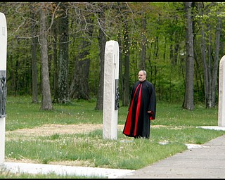 5.13.2009 Monsignor Spinoza  stands by one of the new stations of the cross at the North Jackson  National Shrine of Our Lady of Lebanon.