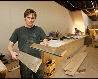 The Lemon Grove, the café opening mid-June in downtown  Youngstown, will be open to press. Jacob Harver, the proprietor of the The Lemon Grove, a cafe under construction in downtown Youngstown, displays construction materials for the interior floor and bar that were salvaged from a 160 year old barn from Brookfield, OH.