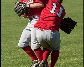 5.20.2009 Columbiana's Matt Wise (1) collides with teamate Josh Harold (11) after Wise catches a fly ball during the bottom of the fourth inning at Cene Field on Wednesday afternoon. Wise was able to hold onto the ball for an out.