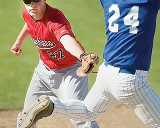 Columbiana's (27) Jay Williamson attempts to tag McDonald's Anthony Raschilla (24) on his way to first base during the bottom of the third inning at Cene Field on Wednesday afternoon. Raschilla was called out at first ending the inning.