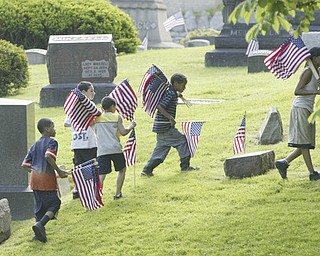 Members of a youth group from American Legion Post 732 in Youngstown were helping decorate veterans graves at Oak Hill Cemetery in Youngstown.