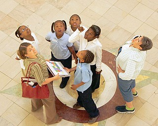 The Center for Urban Studies' Rachel Dodato, bottom left, looks at the rotunda with, clockwise from right, Rayvanne Bennett, Shamya Williams, Taia Wright, Tionia Wallace, Dawon Townsend and and their teacher Mrs. Sylvia Busby.