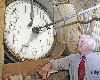 Columbiana County Commissioner Jim Hoppel inspects the inside of the courthouse clock.  Efforts are underway to repair and restore the clock atop the historic Columbiana County Courthouse in downtown Lisbon.