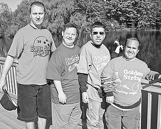 <p>Special to The Vindicator</p> <p>FISHING FOR A GOOD TIME: Enjoying the fishing deck at Farmer Casey's Ranch are Golden String clients, from left, Russell Pavlov, Richard Stanton, Bryan Apgar and Derrick George. Proceeds generated from last year's golf outing went directly to the construction of the handicap-accessible pier and other renovations at the ranch. </p>