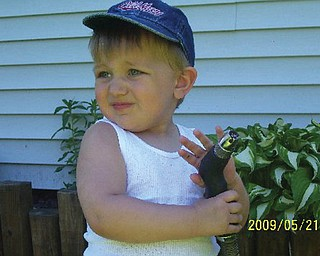 JUSTIN BISH of Hubbard, who will turn 2 on Tuesday, posed for his grandmother, Pam Filo of Hubbard.