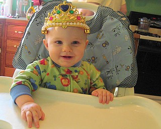 CHLOE WILLIAMS, 8 months, of Lordstown is relaxing on a Saturday in her favorite pajamas and crown.