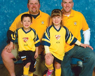 The Saturday suits for these members of the CMIL family are their soccer uniforms. Brothers Ray Cmil III, back left, and Ryan Cmil, back right, coach the St. Charles Soccer Team. On their team are Ray IV and Olivia, 5 1/2-year-old twins of Ray and his wife, Rebecca, of Boardman.