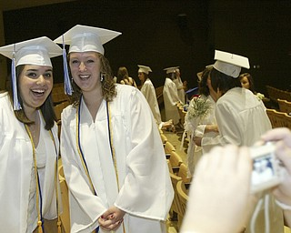 Poland seniors Kati Hartwig, left, and Beth Ann Yoblonkai pose for a pix before the Sunday commencement ceremony.
