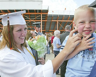 Springfield grad Laura Krcelic greets her nephew Brian Krcelic, 4, after Sunday commencement.