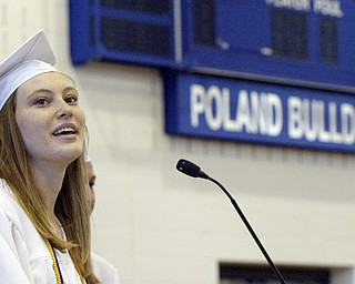 Poland HS valedictorian Christina Rogers delivers her speech during Sunday commencement  at the Poland HS fieldhouse.