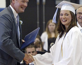 Poland BOE member Dave Bennett presents a diploma to Erin Sweeney, one of 220 to receive diplomas at the Sunday ceremony held in the Poland HS fieldhouse.