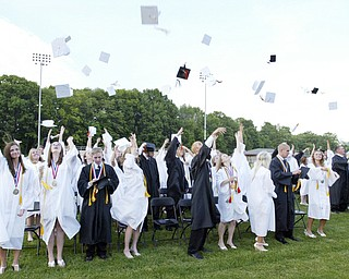 Springfield grads toss their caps  during Sunday commencement.