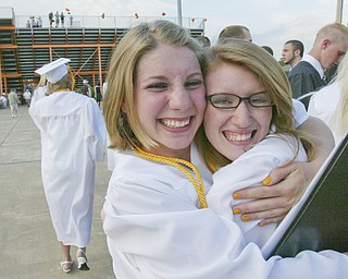 Springfield grads Heather Cozak, left, and Aubrey Bullen hug after Sunday commencement.