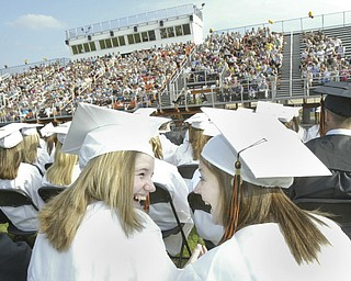 Springfield grads Erin Van Fosson, left, and Amber Uscianowski share a moment during Sunday commencement.