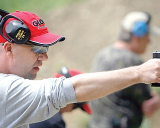 Sgt. Chris Moffitt of Hubbard trains with his Glock at the Hubbard Police Dept. Training Grounds