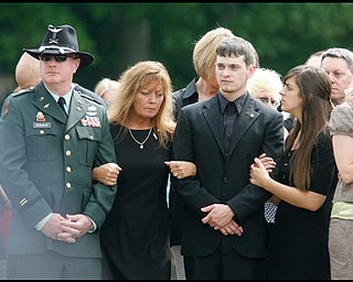 James Siebenaler, mother, Renee Possert, brother, William Panning and sister, Janelle, wait for the casket carrying their son and brother, Army Chief Warrant Officer S. Blane Hepfner,  to be laid to rest at Hubbard Union Cemetery.