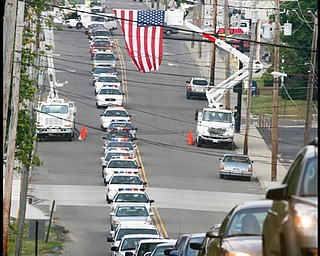 The City of Hubbard pays tribute to  Army Chief Warrant Officer S Blane Hepfner as his funeral procession travels along Liberty St  in Hubbard.