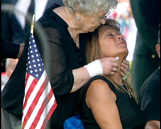 Renee Possert is comforted by her mother Rhodena Orr as Army Chief Warrant Officer S. Blane Hepfner  is laid to rest at Hubbard Union Cemetery.