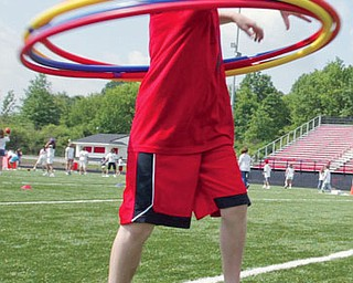 A C.H. Campbell 4th grader hula hoops during end of year field day Tuesday at Canfield High School. Students from C.H. Campbell and Hilltop participated in the event.