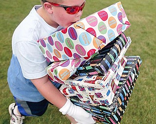 Fifth grader Alex Weimer balances packages in a relay race at Poland North Elementary.