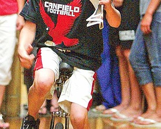 Canfield Middle School student CJ Frost rode a unicycle in the schools talent show Thursday