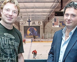 Pittsburgh Penguin, Ruslan Fedotenko, and Youngstown Phantoms President, Alex Zoldan, pose for a photograph at the Ice Zone while Fedotenko's two step-sons Derek and Larkin Jacobson tryout for a spot on the Youngstown Phantoms.
