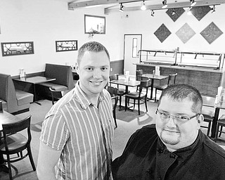 Fourth Street Cafe owner Evan Egli, left, and Chef Stephen Grant  in dinging room at the Salem Eatery. The restuarant recently opened    WD LEWIS
