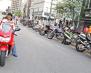 """National Vice President of Ridaz Block Motorcycle Club Myzchiff of Youngstown talks with Shaunte Williams of Youngstown while she's on her Suzuki Katana on West Federal Plaza for """"Rally in the Valley""""  Sunday June 14, 2009Lisa-Ann Ishihara"""