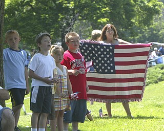 home made welcome - Mary Padgett holds her American afghan flag as the MVPA 2009 Transcontinental Motor Convoy arrives in East Palestine  Monday afternoon - robertkyosay