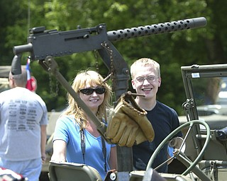 a machine gun mounted in a wwII jeep w/ baseball glove - draws the attention of  Cheryl Thompson and her son Joel of East Palestine - the MVPA 2009 Transcontinental Motor Convoy arrives in East Palestine  Monday afternoon - robertkyosay