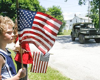 Sara and Robert 8 and 9 respectively ( Buskirk ) wave  old glory as the MVPA 2009 Transcontinental Motor Convoy arrives in East Palestine  Monday afternoon - robertkyosay