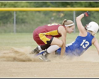 6.16.2009 Mooney's Katie Hughes (9) braces for impact with the ball as Maplewood's Parra Snyder (13) slides into second base during the top of the third inning at Candlelite Knolls in Bazetta Ohio on Tuesday afternoon. Hughes was able to hold onto the ball outting Snyder. Photo by: Geoffrey Hauschild