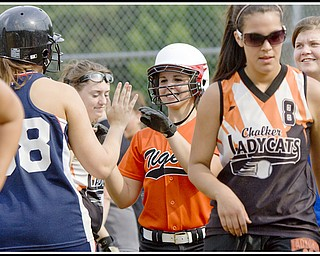 6.16.2009 Howland's Jena Debiec (13) hits the first of back to back homeruns during the top of the fifth inning at Candlelite Knolls in Bazetta Ohio on Tuesday afternoon.  Photo by: Geoffrey Hauschild