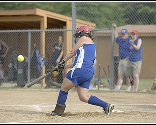 6.16.2009 Maplewood's Emily Paris (8) hits the second of back to back homeruns during the top of the fifth inning at Candlelite Knolls in Bazetta Ohio on Tuesday afternoon. The previous homerun being hit by Howland's Jena Debiec (13). Photo by: Geoffrey Hauschild