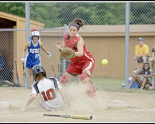 6.16.2009 Canfield's (10) Kellie Kollat slides safely into home as Niles' Melyssa Spowart (25) misses the the throw from teamates during the bottom of the fifth inning at Candlelite Knolls in Bazetta Ohio on Tuesday afternoon. Photo by: Geoffrey Hauschild