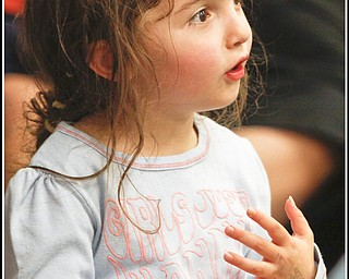 Katina Ticoras (3) of Howland sings along to Chip Richter as he performs in the Media Room at Hubbard Local Library Monday June 15, 2009 Photo by: Lisa-Ann Ishihara