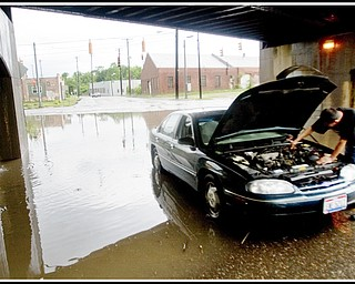 6.17.2009 Flooding on Marshall St. in front of its intersection with Oak Hill Ave. Photo by: Geoffrey Hauschild