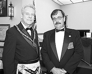 <p>Special to The Vindicator</p> <p>NEW home: Among those involved in a ceremony at which a new complex was dedicated to Masonic purposes by Niles Council 130 were, from left, Fred A. Boggs, Grand Master of Royal and Select Masons of Ohio, and James C. Cunningham of Austintown, illustrious master of Niles Council 130.</p>