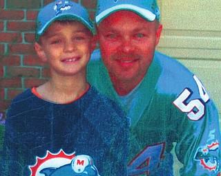 Brian Carr, 44, and McKennan, 10, of North Benton.